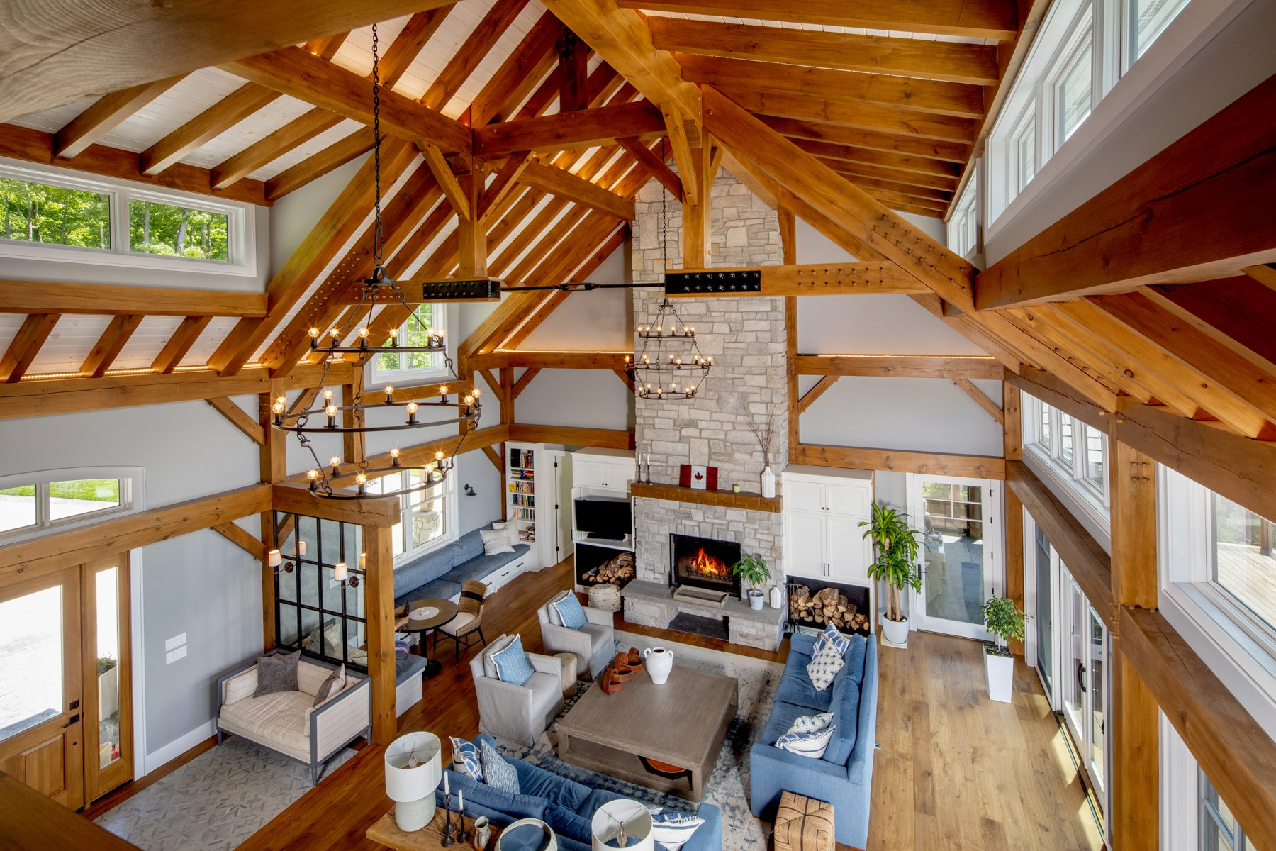Normerica-Timber-Homes-Timber-Frame-Portfolio-Beachside-Bliss-Interior-View-to-Living-Room-from-Loft-Cathedral-Ceiling-Open-Concept